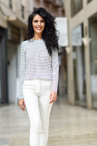 Woman model of fashion wearing casual clothes smiling