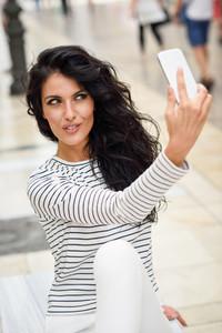 Woman  model of fashion  selfie in the street
