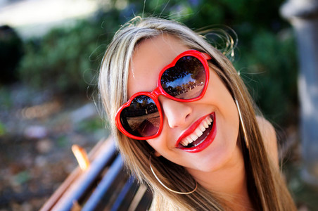 Funny girl with red heart glasses