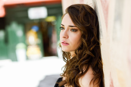 Beautiful young woman with blue eyes in urban background