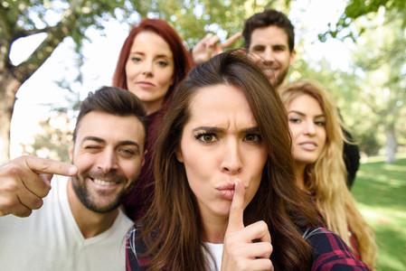 Group of friends taking selfie in urban background