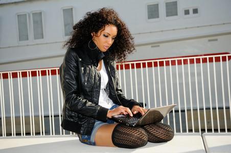 African woman using laptop