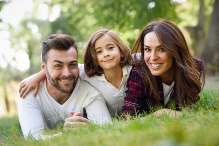 Happy young family in a urban park