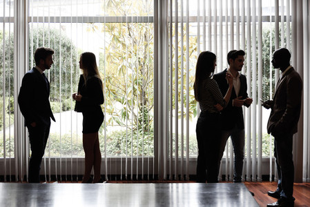 Silhouettes of businesspeople interacting background business ce