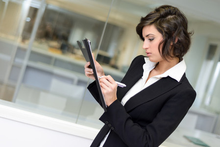 Business woman in an office  Crossed arms