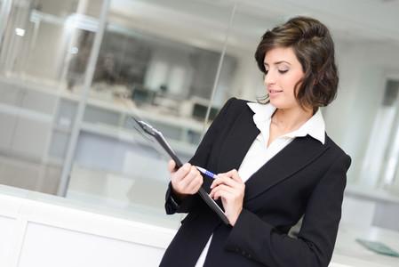 Businesswoman in modern glass interior