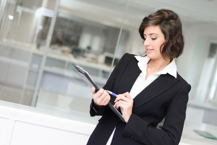 Businesswoman in modern glass interior