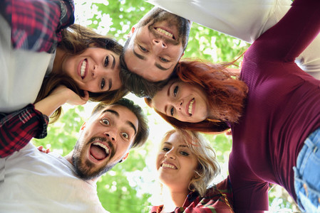 Group of young people together outdoors in urban background