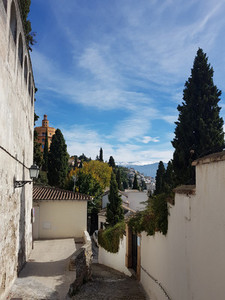 Granada street in the Realejo neighborhood with views of the Sierra Nevada