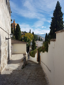 Granada street in the Realejo neighborhood with views of the Sie