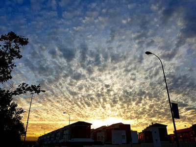 Sunset at city of Granada with beautiful clouds