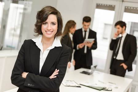 Business leader looking at camera in working environment