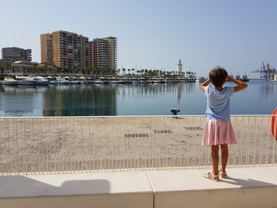 Little girl looking at the Port of Malaga