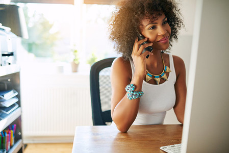 Pretty black girl using smartphone