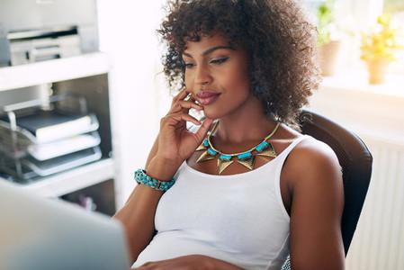 Pensive black girl using pc