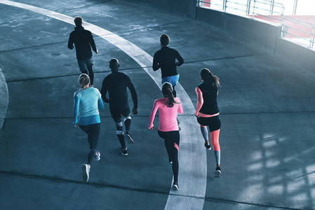 Sportspeople training on race track