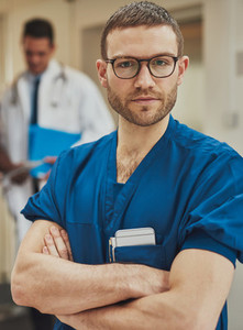 Serious surgeon looking intently at the camera