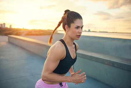 Attractive fit woman training in the early morning