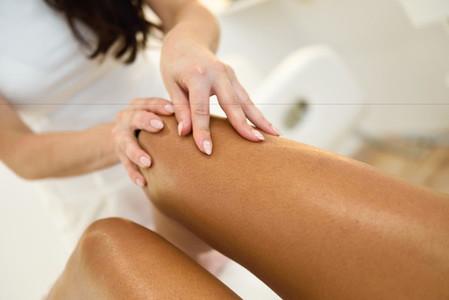 Beauty massage in the leg in a beauty salon