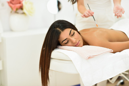 Arab woman in wellness beauty spa having aroma therapy massage
