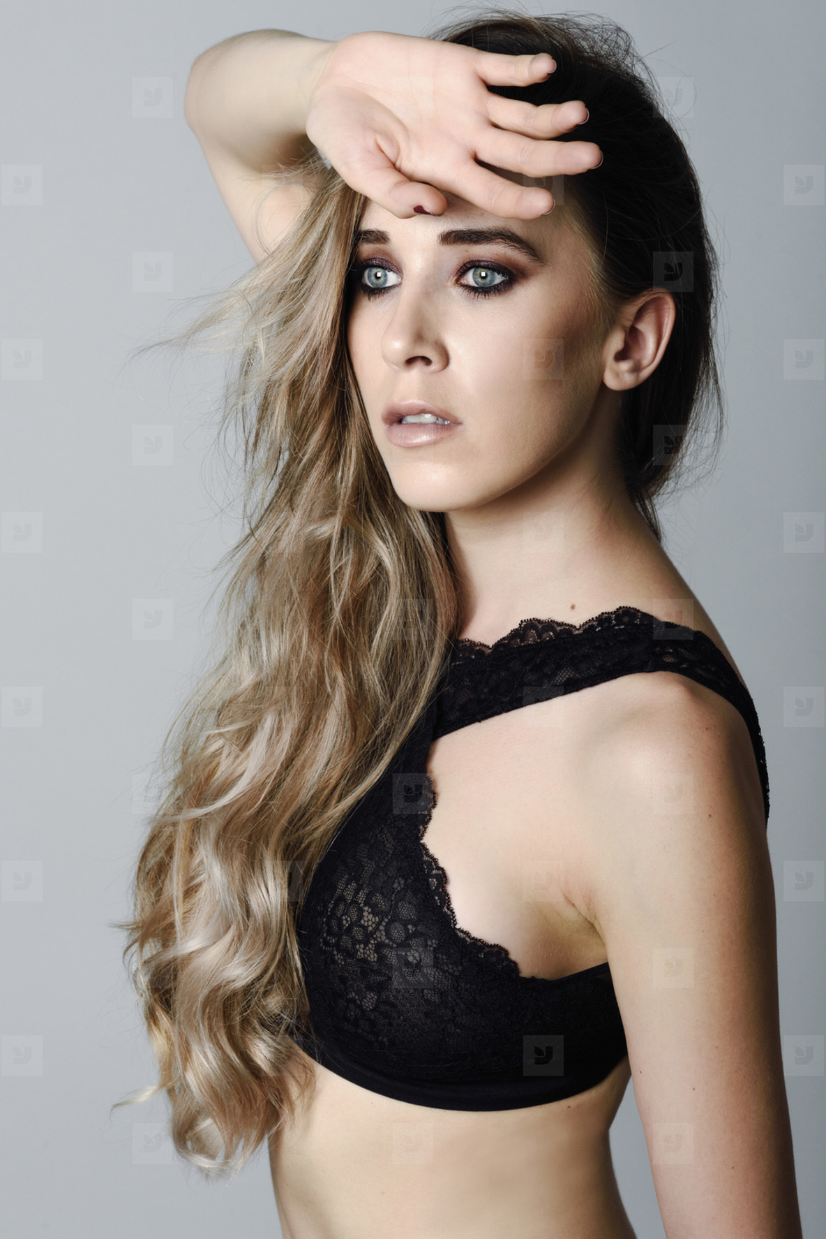 Woman with long hair and blue eyes wearing black lingerie
