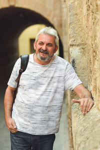 Mature man smiling in urban background