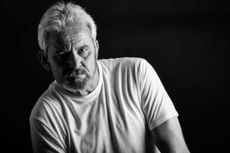 Serious mature man with white hair and beard