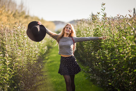 Blonde young woman happy in rural road