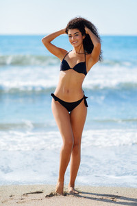 Young arabic woman with beautiful body in swimwear smiling on a