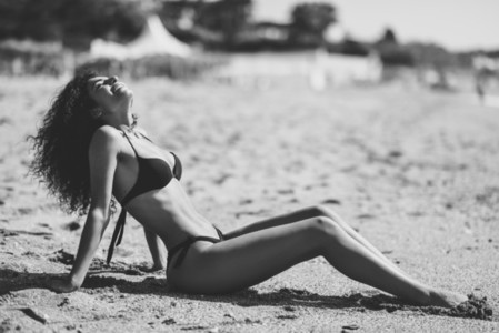 Arabic woman with beautiful body in bikini lying on the beach sa