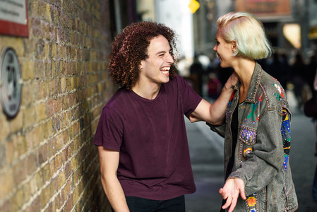Young couple talking in urban background on a typical London street