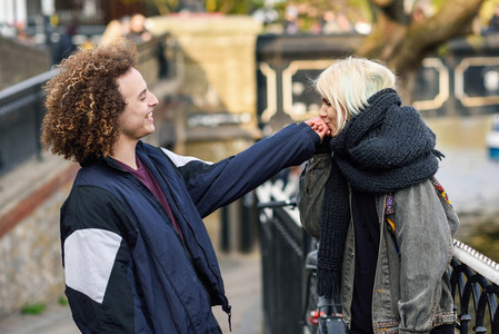 Young woman kissing the hand of her boyfriend in Camden Town Little Venice