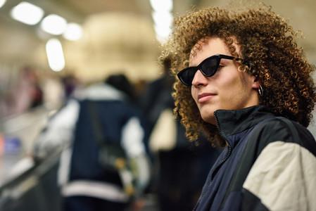 Young man going upstairs at a subway station