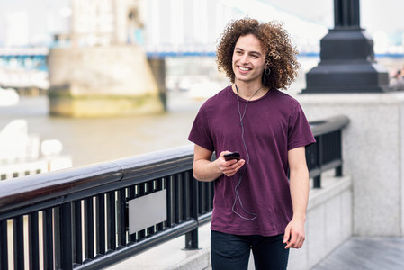 Man listening to the music in urban background