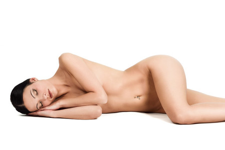 Young naked woman laying on white background