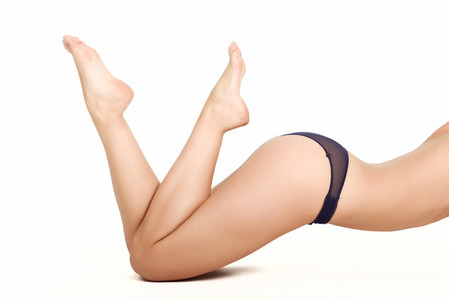 Unrecognizable woman with beautiful legs wearing black panties