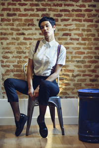 Beautiful young woman  model of fashion  with very short haircut