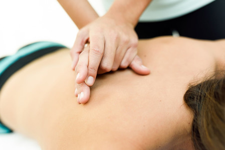 Young woman receiving a back massage in a spa center