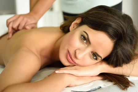 Young female receiving a relaxing back massage in a spa center