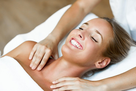 Young woman receiving a head massage in a spa center