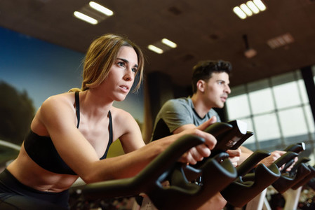 Couple in a spinning class wearing sportswear