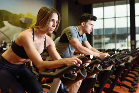 Couple in a cyclo indoor class wearing sportswear
