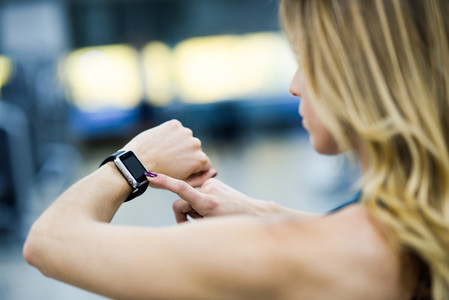 Woman using smart watch at the gym
