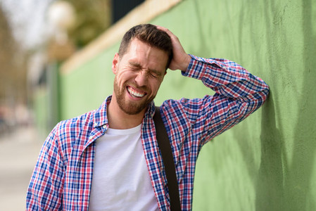 Attractive young man laughing outdoors  Lifestyle concept
