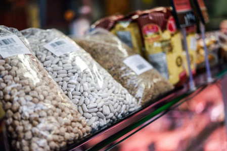 Bags of dried legumes for sale in a store