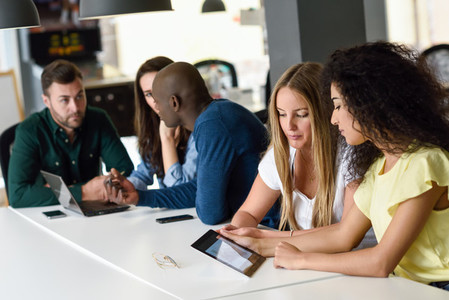 Multi ethnic group of young people studying with laptop computer