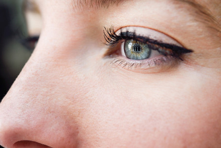 Close up shot of blue eye of young woman