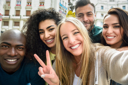 Multiracial group of young people taking selfie