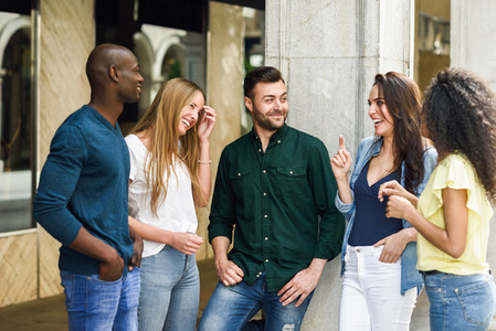 Multi ethnic group of friends having fun together in urban background