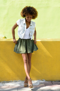 Young black woman  afro hairstyle  standing in urban background